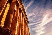 Photo of Baalbek Heliopolis ruins, ancient Lebanon landmark over dark blue sky, arabian architecture, antique religions building, famous jupiter monument, columns statue, retro style image poster