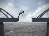 pic of jumping  - Business concept of businessman overcome the problems - JPG