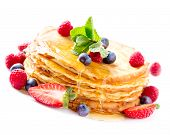 Pancake. Crepes With Berries. Pancakes stack with Strawberry, Raspberry, Blueberry and Syrup isolate