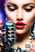 stock photo of microphone  - Singing Woman with Retro Microphone - JPG