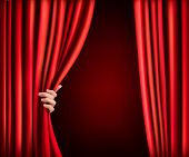 picture of cinema auditorium  - Background with red velvet curtain and hand - JPG