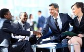 stock photo of latin people  - Business people shaking hands - JPG