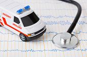 pic of ambulance car  - Stethoscope and ambulance car on ecg  - JPG