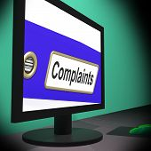 foto of moaning  - Complaints On Monitor Showing Angry Customers Or Moans - JPG
