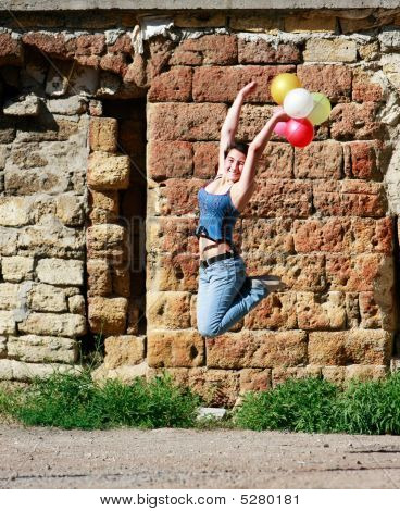 Happy Girl Jumping With Balloons On Grunge Background