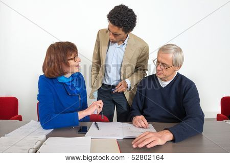 Business people talking with their tutor during a supplementary training session