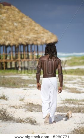 Man Walking On The Beach In Cuba