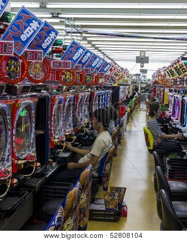 Players In Pachinko Parlor, Osaka, Japan.