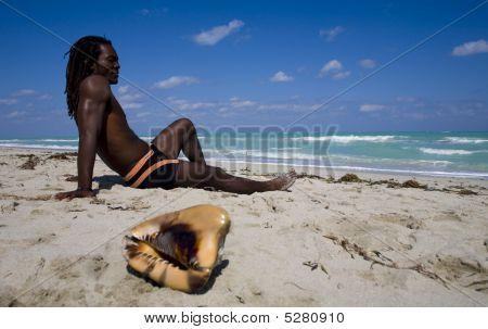 Man Sitting On The Beach In Cuba