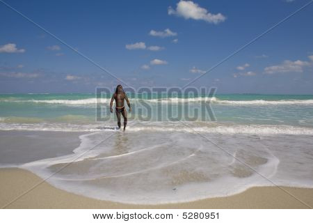 Man Going Out The Sea In Cuba