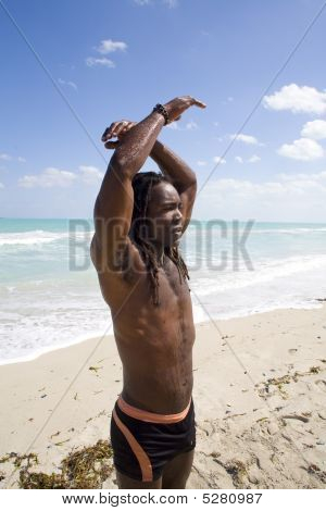 Man Raising Arms In Cuba