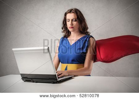 superwoman working on the computer