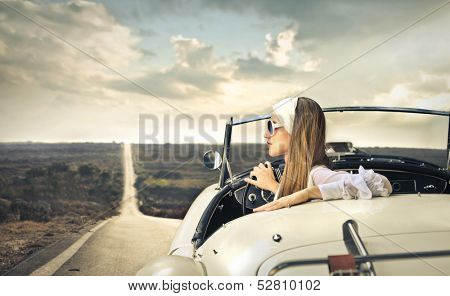 beautiful woman traveling on a vintage car