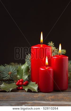 Christmas candles with evergreen decorations.