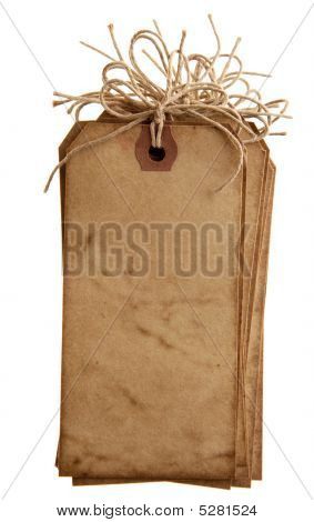 Vintage Grunge Paper With Bow String Tags Stacked, Isolated On White