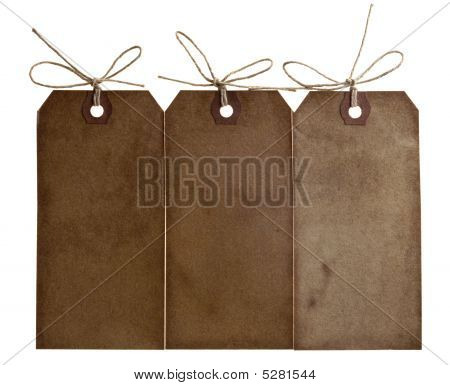 Three Different Grunge Paper Tags With Bow String, Isolated On White