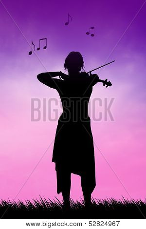 Violinist At Sunset