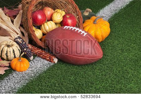 Football With A Cornucopia On Grass Field