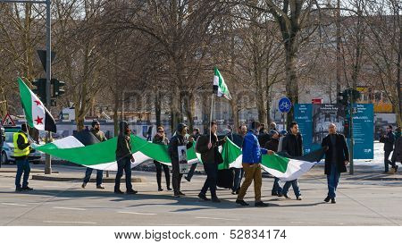 Pro-opposition Activists Carrying The Syrian Flag On Demonstration