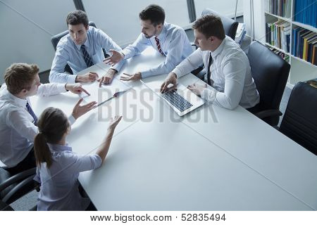 Five business people having business meeting at the table