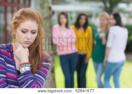 Female student being bullied by other group of students