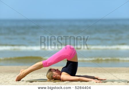 Young Woman Workout On The Beach