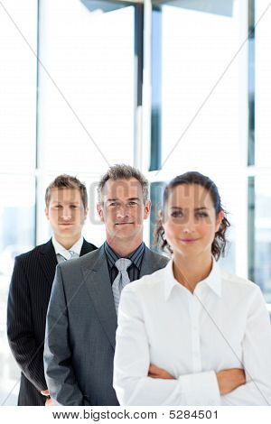 Matureusinessman In A Line With His Business Team