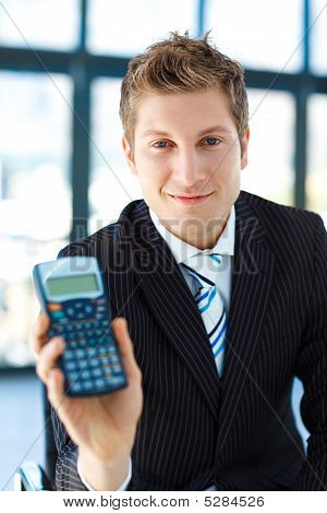 Young Businessman Holding A Calculator