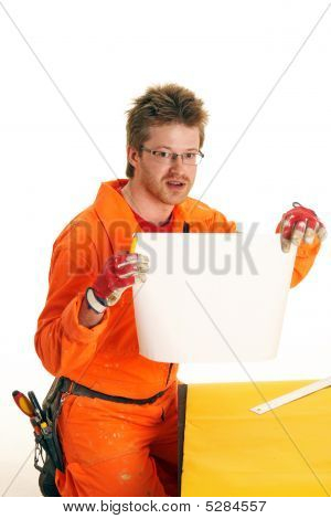 Worker Holds The Sheet Of White Paper