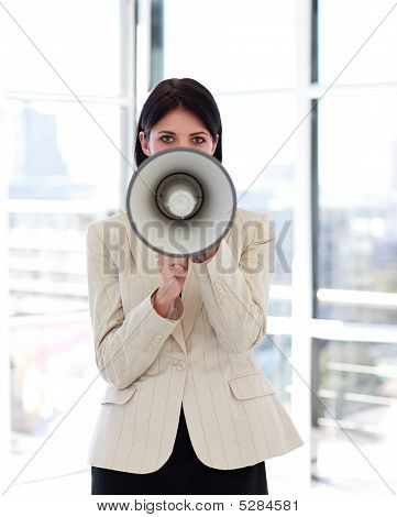 Businesswoman Shouting Through Megaphone To The Camera