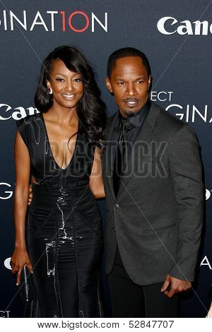 NEW YORK- OCT 24: Actress Nichole Galicia (L) and Jamie Foxx attend the global premiere of Canon's