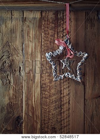 Handmade christmas star on a wooden wall