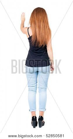 back view redhead woman. Young woman presses down. Isolated over white background. Rear view people collection. backside view of person. she holds his hand open, palm forward