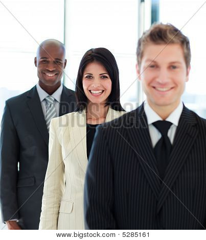 Beautiful Businesswoman In Focus With Her Team
