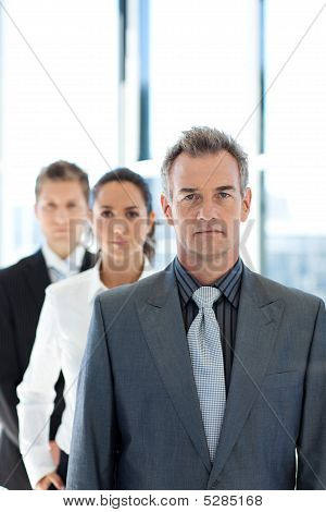 Businessman Leading A Business Team In A Row