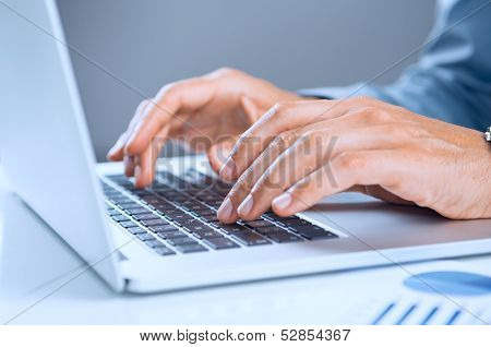 Close Up Of A Businessman's Hand On Laptop Keypad