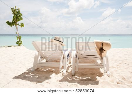 Two Sun Lounges Facing The Sea