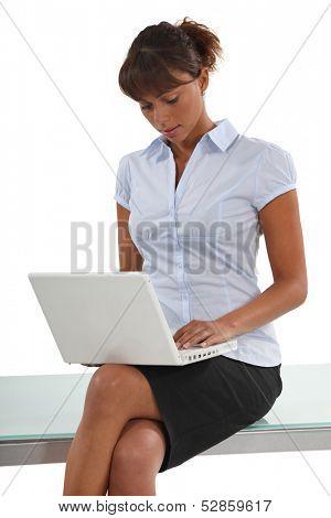 Businesswomanusing her laptop