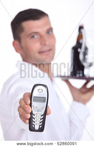 Waiter holding cell phone