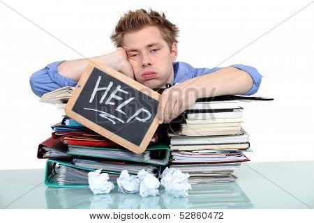 student swamped under work