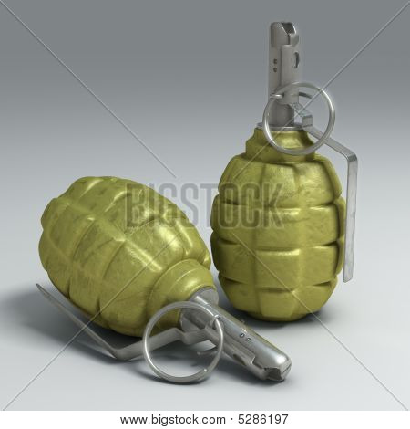 Two Fragmentation Hand Grenades On Light Surface