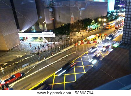 Cars Passing The Salisbury Road By Night In Kowloon, Hong Kong