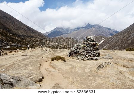 Buddhists Prayer Flags And Stone Pyramids Often Marks The Mountain Pass Or Holy Place In Himalayas