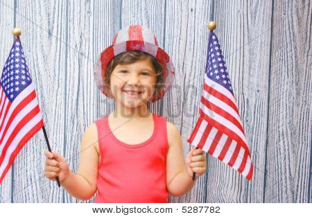 Young Girl Waving Flags