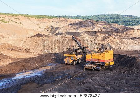 Truck And Electric Shovel In Open Pit North Of Thailand