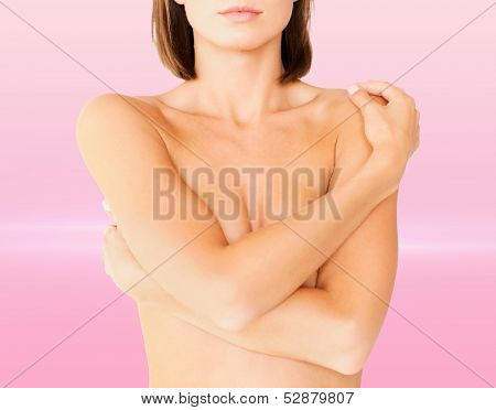 health, medicine, beauty concept - topless woman with perfect skin and hands over breast