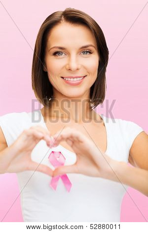 healthcare and medicine concept - woman in blank t-shirt with pink breast cancer awareness ribbon showing heart shape