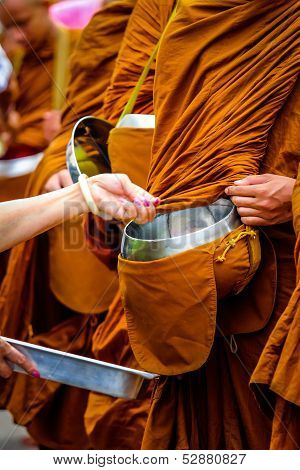 Giving to thai monks