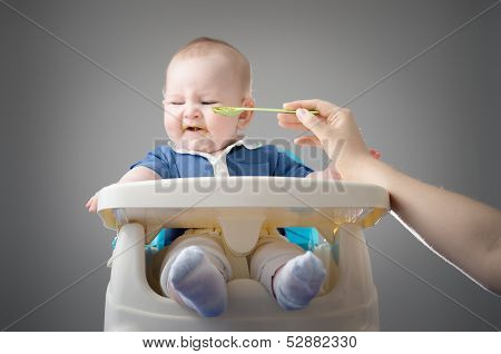 Meal Time. Funny Baby Refuses To Eat.