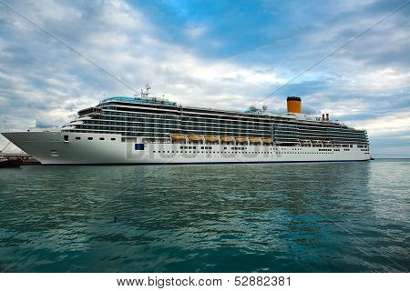 Cruise Ship In The Sea On The Background Of Blue Sky With Clouds